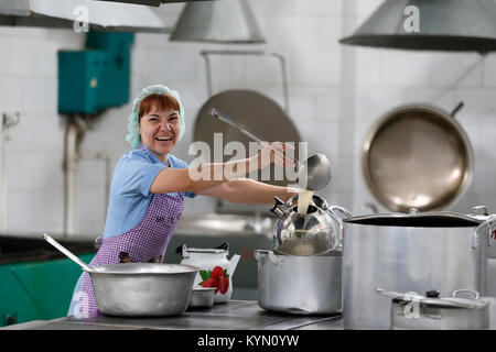 City of Gomel Belarus  01 June 2017.Industrial kitchen in a medical hospital.Woman cook in an industrial kitchen - Stock Photo