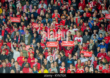 CARDIFF, WALES - OCTOBER 09: Fans sing the national anthem ahead of the FIFA World Cup qualifying match between - Stock Photo