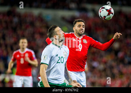 CARDIFF, WALES - OCTOBER 09:( L-R )  Shane Duffy of Ireland and Hal Robson-Kanu of Wales jump for the ball during - Stock Photo