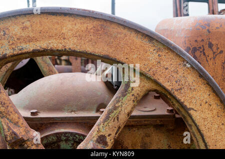 Rusty section of a wheel on an abandoned tractor - Stock Photo
