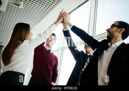 The happy business people greeting in modern office - Stock Photo