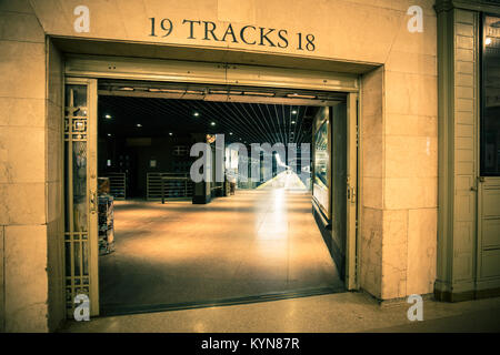 Grand Central Terminal Station in New York City, view of train tracks through entrance door - Stock Photo