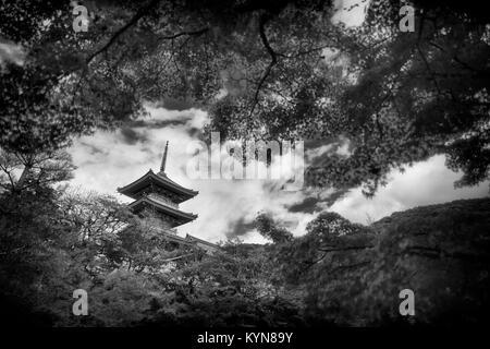 Dramatic artistic black and white photograph of Sanjunoto pagoda of Kiyomizu-dera Buddhist temple in Kyoto, Japan - Stock Photo