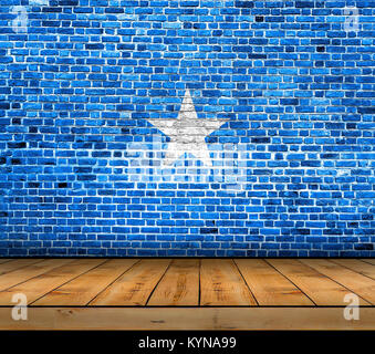 Somalia flag painted on brick wall with wooden floor - Stock Photo