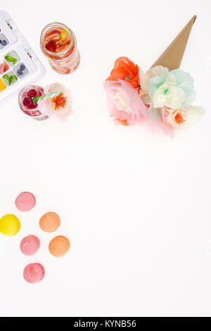 top view of decorative flowers with macaroons and fruity cocktails isolated on white - Stock Photo