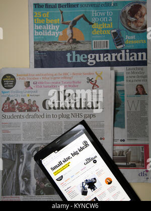 'Guardian' newspaper switches from Berliner to tabloid format, London: three generations of editions shown - final - Stock Photo