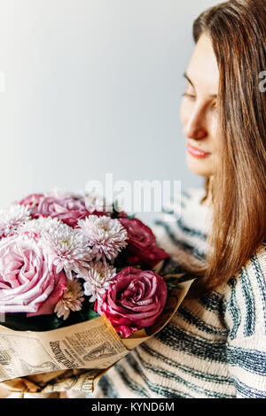 Beautiful Girl And Purple Roses Flower Bouquet Present - Stock Photo
