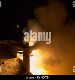 The Soyuz MS-06 spacecraft launches from the Baikonur Cosmodrome in Kazakhstan with Expedition 53 crewmembers Joe - Stock Photo