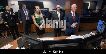 Vice President Mike Pence, right, talks with Expedition 53 crew members Joe Acaba, Randy Bresnik, and Mark Vande - Stock Photo