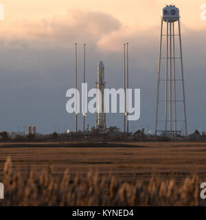 The Orbital ATK Antares rocket, with the Cygnus spacecraft onboard, is seen on launch Pad-0A, Saturday, Nov. 11, - Stock Photo