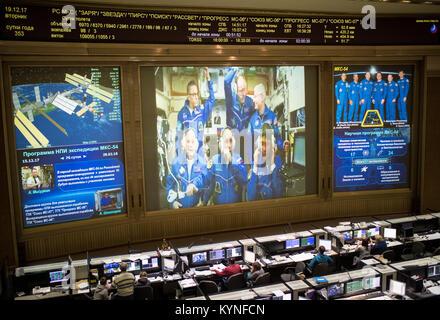 Expedition 54 flight engineers Scott Tingle of NASA, bottom left, Anton Shkaplerov of Roscosmos, bottom center, - Stock Photo