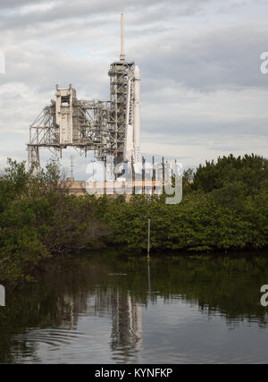 The SpaceX Falcon 9 rocket, with the Dragon spacecraft onboard, is seen at Launch Complex 39A at NASA's Kennedy - Stock Photo