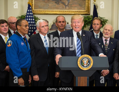 President Donald Trump, center, speaks before signing an Executive Order to reestablish the National Space Council, - Stock Photo