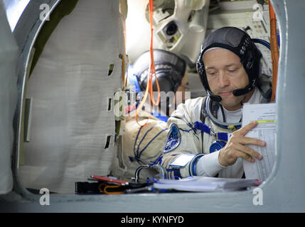 Expedition 52 backup crew member Alexander Misurkin of Roscosmos reviews his paperwork as he and Expedition 52 backup - Stock Photo