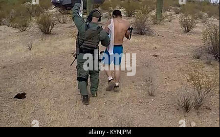 TUCSON, Ariz. – Tucson Sector Border Patrol agents assigned to the Mobile Response Team (MRT) responded to a 911 - Stock Photo