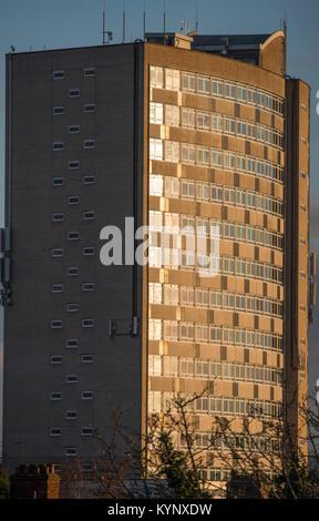 London, UK. 15th Jan, 2018. London Borough of Merton's 1960's style high rise Civic Centre building catches evening - Stock Photo