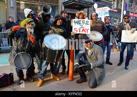 New York, USA. 15th Jan, 2018. Group of Haitian musician at the rally playing and dancing with the crowd. Credit: - Stock Photo