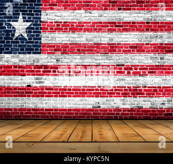 Liberia flag painted on brick wall with wooden floor - Stock Photo