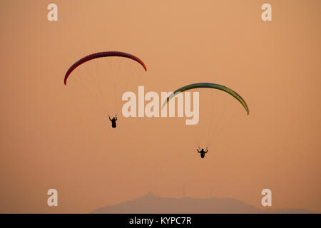 Paragliding at sunset in Pokhara, Nepal - Stock Photo