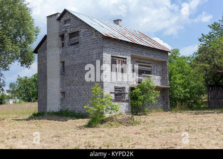 Unfinished, ruined and abandoned house - Stock Photo