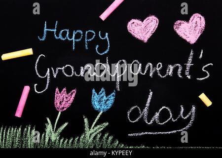 Happy Grandparents day card - Chalk drawing on blackboard - Stock Photo