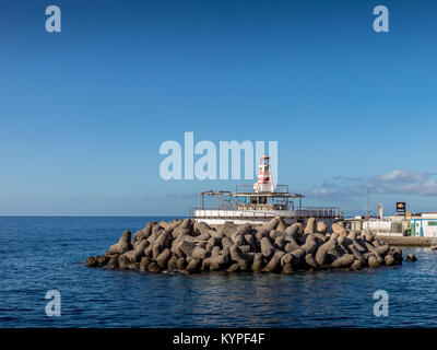 Breakwater blocks in the port of Mogan, Gran Canaria, with the Atlantic Ocean in the background - Stock Photo