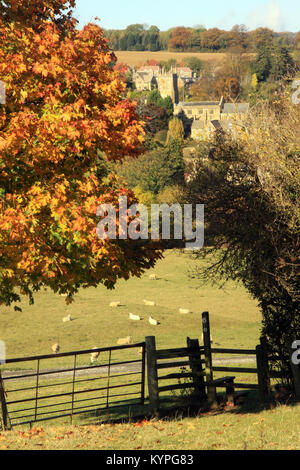 View over Cotswolds farmland to the village of Blockley in the  Gloucestershire countryside England uk during Autumn - Stock Photo