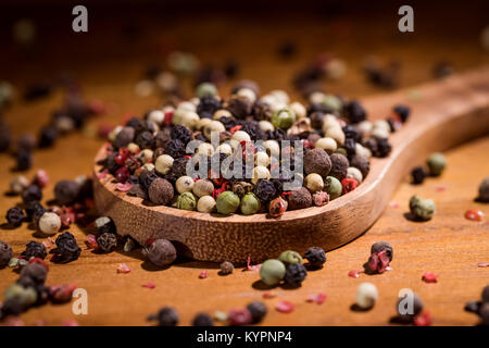 Mixed peppercorns. Dry mix peppercorns close up - Stock Photo