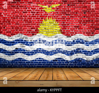 Kiribati flag painted on brick wall with wooden floor - Stock Photo