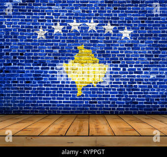 Kosovo flag painted on brick wall with wooden floor - Stock Photo