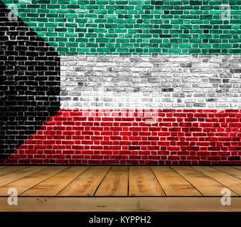 Kuwait flag painted on brick wall with wooden floor - Stock Photo