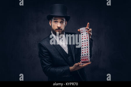 Magician showing trick with playing cards. - Stock Photo