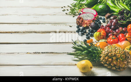 Helathy raw vegan food cooking background. Fresh fruit, vegetables, greens, superfoods over white wooden table, - Stock Photo
