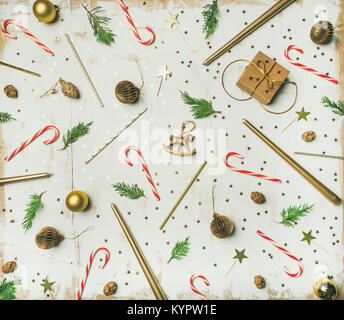 Getting ready for Christmas or New Year celebration party. Flat-lay pattern of holiday decoration objects, toys, - Stock Photo