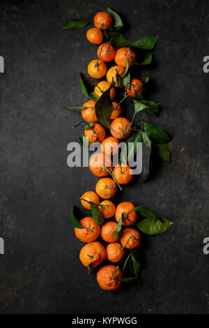 Clementine oranges on a black background - Stock Photo