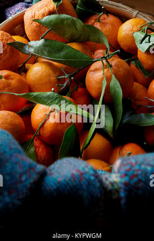 Clementine oranges in a basket - Stock Photo