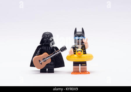 lego vacation batman with darth vader holding a guitar isolated on white background. - Stock Photo
