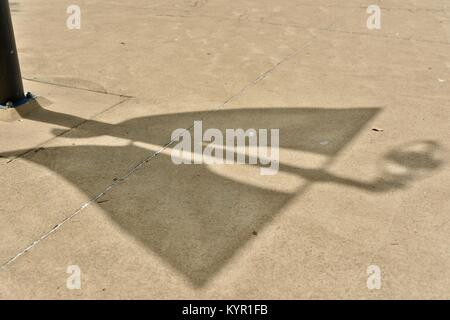 Shadows and patterns  on the pavement and walkways around Riverway, Townsville, Queensland, Australia - Stock Photo