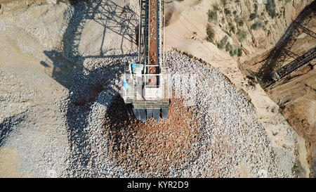 Stone sorting conveyor belt in a large Quarry - Top down aerial view - Stock Photo