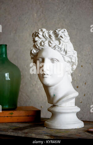 Workshop of a painter or sculptor.Greek bust for practicing techniques and skills. - Stock Photo
