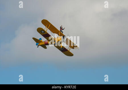 In The Sky, Portrush, Northern Ireland - August 31, 2013:-  An Unknown male is Wing Walking on an old Bi Plane at - Stock Photo