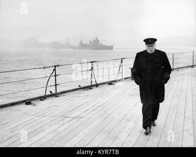 British Prime Minister Winston Churchill walks on deck  of H.M.S. Prince of Wales during the Atlantic Conference - Stock Photo