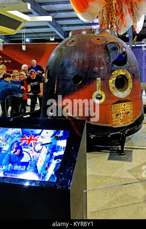 Tim Peakes Soyuz Russian Space Craft capsule and eager school children Shildon Railway Museum - Stock Photo