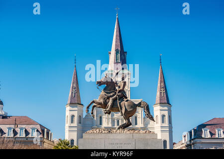 The landmark St. Louis Cathedral and General Andrew Jackson Statue in New Orleans Louisiana USA on a sunny day. - Stock Photo