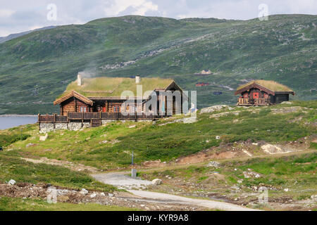 Norwegian  Wooden Houses built in traditional technique used in Viking and Medieval times with grass on the roofs - Stock Photo