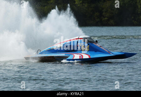 Kevin Kreitzer drives boat A64 on demonstration run. Outboard Hydroplane boat races. Dayton Record Runs Regatta. - Stock Photo