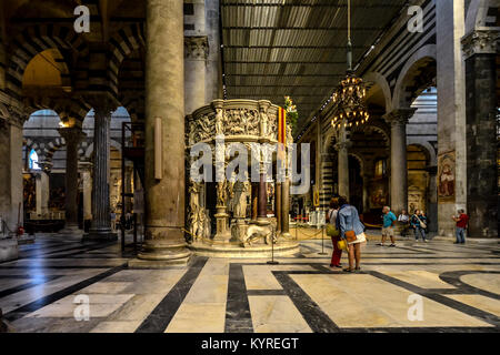 Giovanni Pisano's marble pulpit highlights the interior of the Santa Maria Assunta, Pisa's grand Duomo Cathedral - Stock Photo
