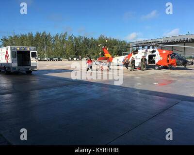 Coast Guard crewmembers aboard an MH-60 Jayhawk helicopter from Air Station Clearwater, Florida, medevac a 45-year - Stock Photo
