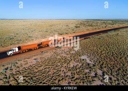 Road train travelling on the Great Northern Highway, Pilbara, Western Australia - Stock Photo