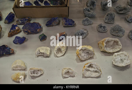 Various semi precious stones displaying on table - Stock Photo